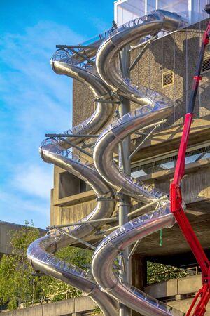 fire brigade: Repair Work Using Crane on metal spiral pipe for fire brigade downhill.  London. UK