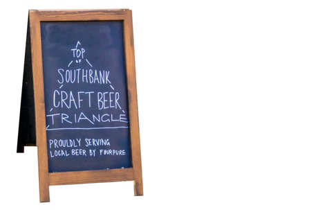 near beer: LONDON, UK - JUNE 6, 2015: Advertising of draft craft beer sale near pub on the south bank of the River Thames Editorial