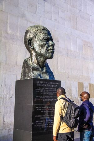 LONDON, UK - JUNE 6, 2015: Unidentified people near Nelson Mandela bust beside Royal Festival Hall at Southbank Centre