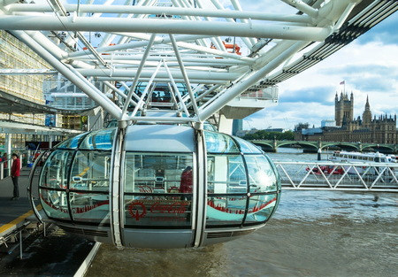 millennium wheel: LONDON, UK - JUNE 6, 2015: Unidentified people inside London Eye  cabin. London Eye is a giant Ferris wheel situated on the banks of the River Thames