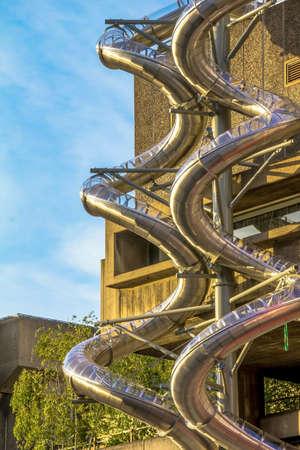 fire brigade: Metal spiral pipe for fire brigade downhill.  London. UK Stock Photo