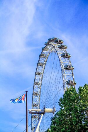 local landmark: LONDON, UK - JUNE 6, 2015: London Eye . London Eye is a giant Ferris wheel situated on the banks of the River Thames