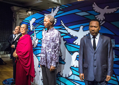LONDON , UK - JUNE 7, 2015:  Wax figures of Nelson Mandela, Dalai Lama ,  Martin Luther King, Jr. in  Madame Tussauds museum.  Madame Tussauds London is famous for recreating famous people and celebrities, in wax. It is located in the former London Planet Editorial