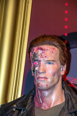 terminator: LONDON, UK - JUNE 7, 2015: Arnold Schwarzenegger as the Terminator in the Madame Tussauds  wax museum. Marie Tussaud was born as Marie Grosholtz in 1761