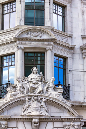 fasade: LONDON , UK - JUNE 7, 2015:  Fasade of one of building on Regents street  It was named after Prince Regent, completed in 1825. Every building in Regent Street is protected as a Listed Building.