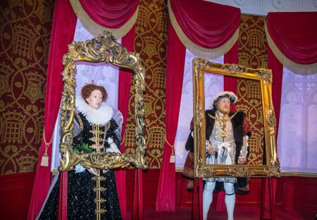 viii: LONDON , UK - JUNE 7, 2015:  King Henry 8th  and Queen Elizabeth I   wax figures  At Madame Tussauds  Museum