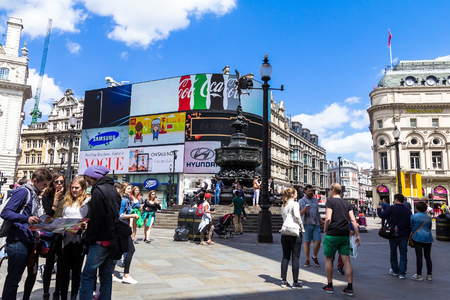 west end: LONDON , UK - JUNE 7, 2015: View of Piccadilly Circus, road junction, built in 1819, famous tourist attraction, links to West End, Regent Street, Haymarket, Leicester Square, on Nov 6, 2010 in London, UK.