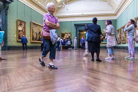 visitors: LONDON, UK - JUNE 7, 2015: Unidentified visitors in one of the halls of the National Gallery