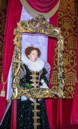 LONDON , UK - JUNE 7, 2015:   Queen Elizabeth I wax figure  At Madame Tussauds  Museum