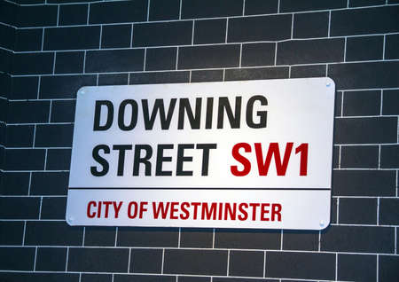 housed: LONDON, UK - JUNE 7, 2015:  Downing Streets sign in Westminster. Downing St. has housed government leaders for over three hundred years. Editorial