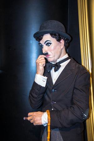 chaplin: LONDON , UK - JUNE 7, 2015:   Charlie Chaplin, the actor, Madame Tussauds museum.. Marie Tussaud was born as Marie Grosholtz in 1761