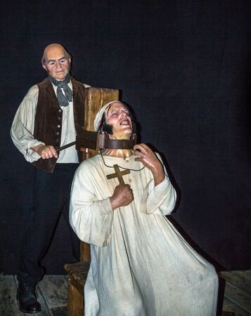 strangulation: LONDON , UK - JUNE 7, 2015:  Executioner  at one of halls of historical part of  Madame Tussauds museum.  Madame Tussauds London is famous for recreating famous people and celebrities, in wax.