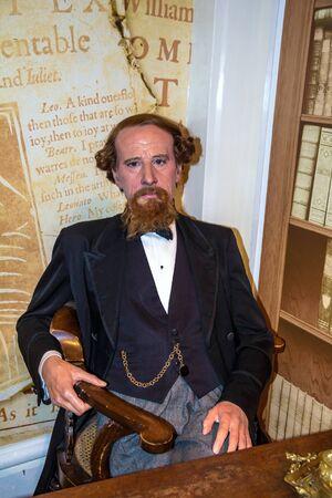 dickens: LONDON, UK -JUNE 7,2015: Wax figure of  world-famous British writer Charles Dickens at Madame Tussauds museum.