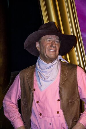 john wayne: LONDON, UK - JUNE 7, 2015: A wax figure of John Wayne is seen on display at Madame Tussauds museum Editorial