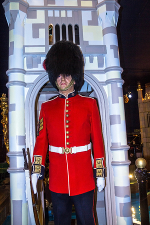 royal: LONDON, UK - JUNE 7, 2015: Wax figure of Royal Guard at  Madame Tussauds museum.  British Guards in red uniform are the sign of London. Editorial