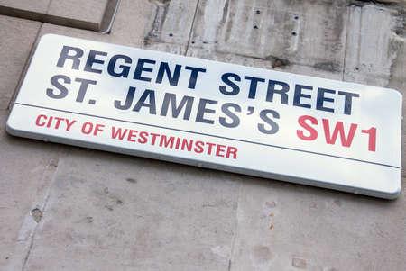 regent: LONDON, UK - JUNE 4, 2015:  REGENT STREET ST. JAMES sign on the stone wall