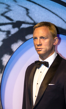 craig: LONDON , UK - JUNE 7, 2015:  Daniel Craig as the agent 007 James Bond in Madame Tussauds museum in London. Marie Tussaud was born as Marie Grosholtz in 1761 Editorial