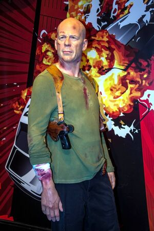 willis: LONDON, UK -JUNE 7, 2015: Bruce Willis as John McClane in the Madame Tussaud  wax museum. Marie Tussaud was born as Marie Grosholtz in 1761