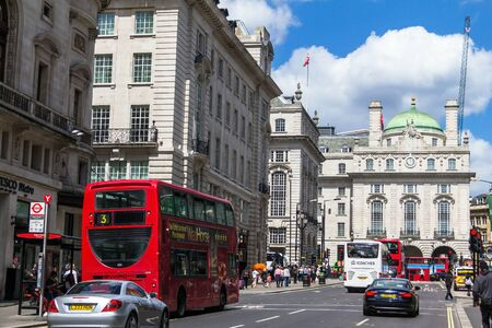 regent: LONDON , UK - JUNE 7, 2015: Regents street . It was named after Prince Regent, completed in 1825. Every building in Regent Street is protected as a Listed Building.