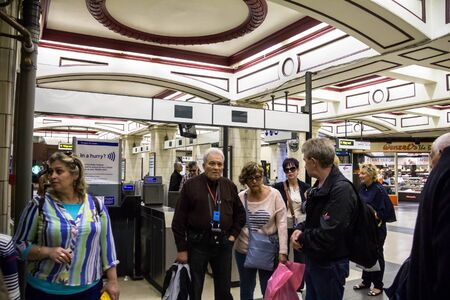 pancras: LONDON, UK - JUNE 7, 2015: Unidentified tourists  inside the Kings Cross underground station