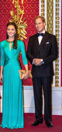 LONDON, UK- JUNE 07, 2015:  Wax figures of Prince William and Kate Middleton are seen on display at Madame Tussauds museum