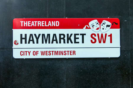 premieres: LONDON, UNITED KINGDOM-JUNE 7, 2015: Street sign marking Londons famous Haymarket in the region known as Theatreland, renowned for hosting UK, European and sometimes world film premieres.