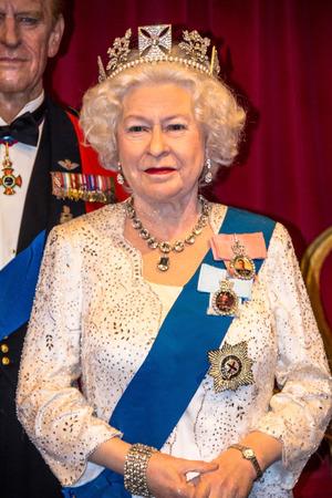 queen elizabeth ii: LONDON, UK- JUNE 07, 2015: Queen Elizabeth II Figurine At Madame Tussauds Wax Museum.