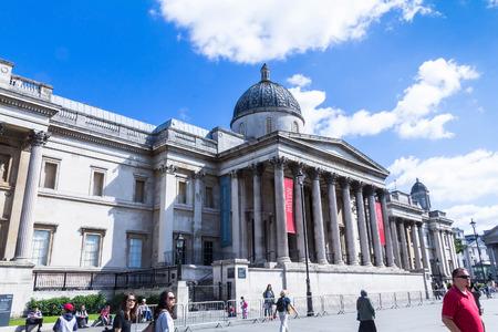 typically english: LONDON, UK - JUNE 7, 2015: Unidentified tourists near National gallery and Trafalgar Square