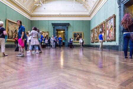 unidentified: LONDON, UK - JUNE 7, 2015: Unidentified visitors in one of the halls of the National Gallery