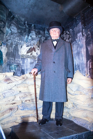 winston: LONDON , UK - JUNE 7, 2015: Winston Churchill at the  Madame Tussauds wax museum. Marie Tussaud was born as Marie Grosholtz in 1761 Editorial