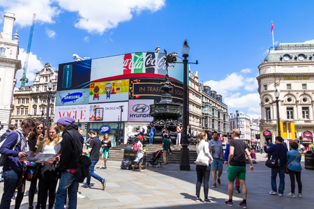 west end: LONDON , UK - JUNE 7, 2015: View of Piccadilly Circus, road junction, built in 1819, famous tourist attraction, links to West End, Regent Street, Haymarket, Leicester Square