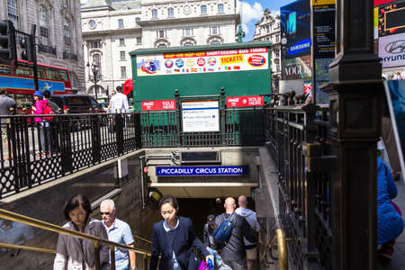 tube station: LONDON - JUNE 7, 2015:  Unidentified people at Piccadilly Circus  underground tube station. Londons underground railway is the oldest in the world, dating back to 1863.