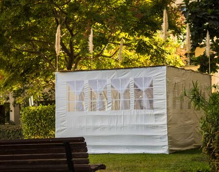 hebrews: Jewish Holiday Sukkot . A sukkah is a temporary hut constructed for use during the week-long Jewish festival of Sukkot. Static shooting Stock Photo