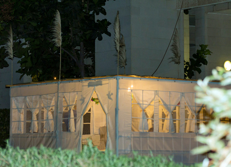 hebrews: Jewish Holiday Sukkot . Evening. A sukkah is a temporary hut constructed for use during the week-long Jewish festival of Sukkot. Static shooting