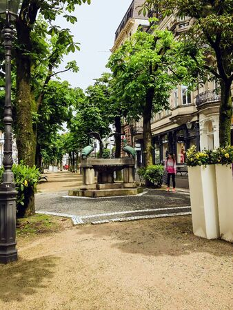 BADEN-BADEN, GERMANY - CIRCA MAY, 2016: The Reiherbrunnen (Herons Fountain) is a thermal water fountain in the Sophienstra�e. The Karlsruhe sculptor Karl Albiker (1878-1961) designed the fountain in the Art Nouveau style