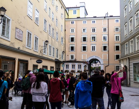 Salzburg, Austria - July 15,2017: Tourists on Hagenau Square is probably one of the most famous squares in Salzburg. Mozart Birthplace officially located at Getreidegasse 9 but actually found on Hagenau Square. Editoriali