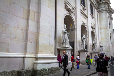 Salzburg, Austria- July 15, 2017: A group of tourists near Baroque cathedral of the Roman Catholic Archdiocese