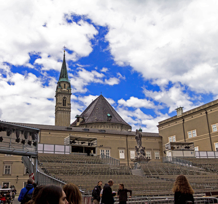 Salzburg. Austria - July 15, 2017: Traditional temporary concert hall in the open air for opera staging with Franciscan (Franziskaner ) Church and cloudy summer sky on background.