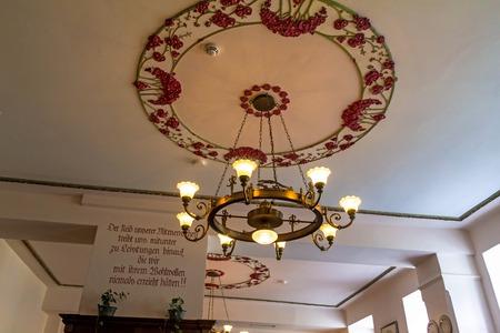 Salzburg, Austria- July 15, 2017: Ancient chandelier in one of the national Austrian cuisine restaurants
