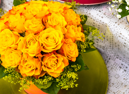 Bouquet of yellow color roses in flower shop on open air at small city market. Salzburg, Austria Stock Photo