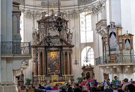 Salzburg, Austria- July 15, 2017: A group of tourists in Baroque cathedral of the Roman Catholic Archdiocese