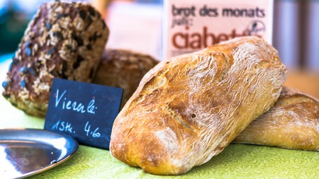 Salzburg, Austria - June 1, 2017: Freshly baked bread from rye flour for sale on Schrannenmarkt, a traditional market on Mirabellplatz.