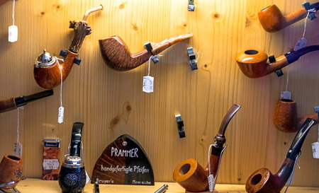 Salzburg, Austria - July 15, 2017: Shop window with a pipe for smoking Sajtókép