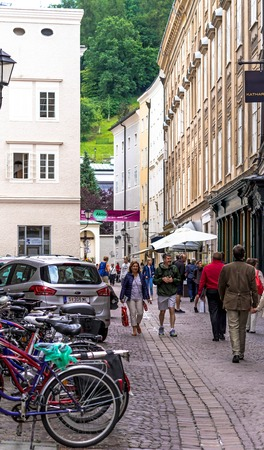 Salzburg, Austria - July 15,2017: View of famous medieval streets of Salzburg, Austria. Currently a lively shopping area. Wolfgang Amadeus Mozart was born