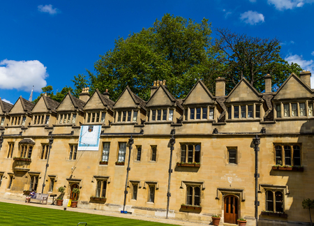 Oxford, UK - June 08,2015 : Old Quadrangle of Brasenose college of Oxford University with sundial, added in about 1719, in the North wall on summer blue sky background.