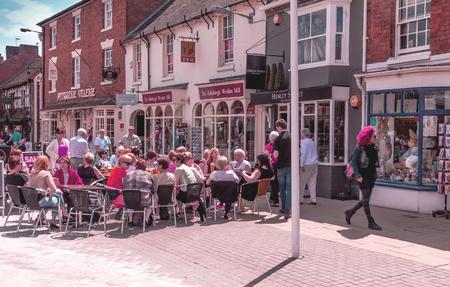 STRATFORD-UPON-AVON, UK - JUNE 8, 2015: Unidentified tourists at Henley Street in the center of Stratford Upon Avon, Warwickshire. England, United Kingdom, Western Europe