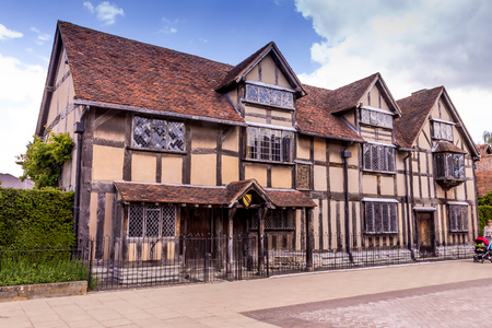 STRATFORD UPON AVON, UK - JUNE 8, 2015: Unidentified tourists and locals at the main street of very touristic town where William Shakespeare was born. There is a house a birthplace on Henley Street