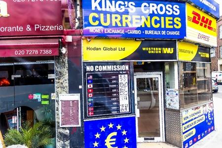 Currency exchange bureau king cross currencies on grays inn.. stock