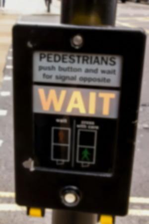 Crosswalk button for pedestrian with light warning. London. UK