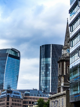 LONDON, UK - June 9, 2015: View of City of London from Aldgate Underground station entrance. London Underground is the 11th busiest metro system worldwide with 1.1 billion annual rides. Stock Photo